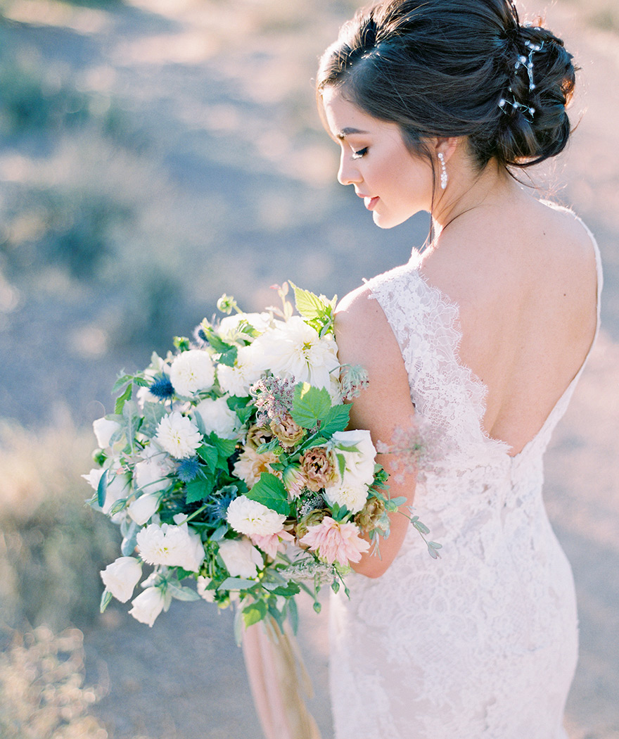lace wedding gown & pale bouquet