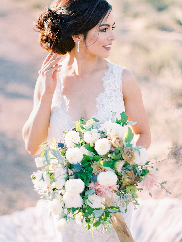 lace wedding gown and pale bouquet