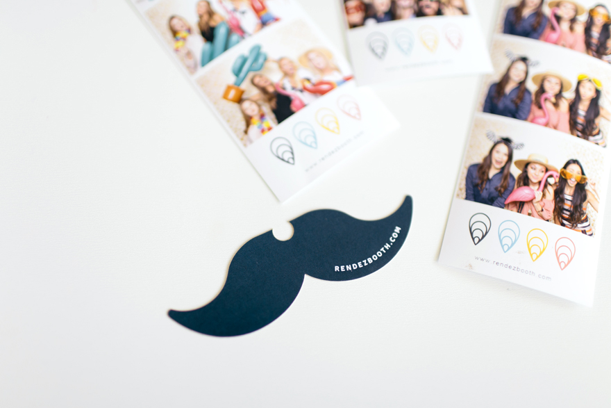 Photo strip souvenirs and moustache-shaped business card