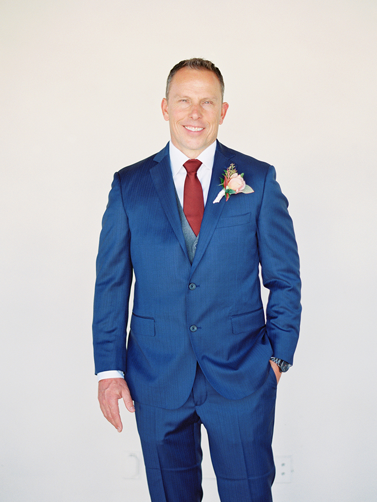stylish groom in a three piece suit