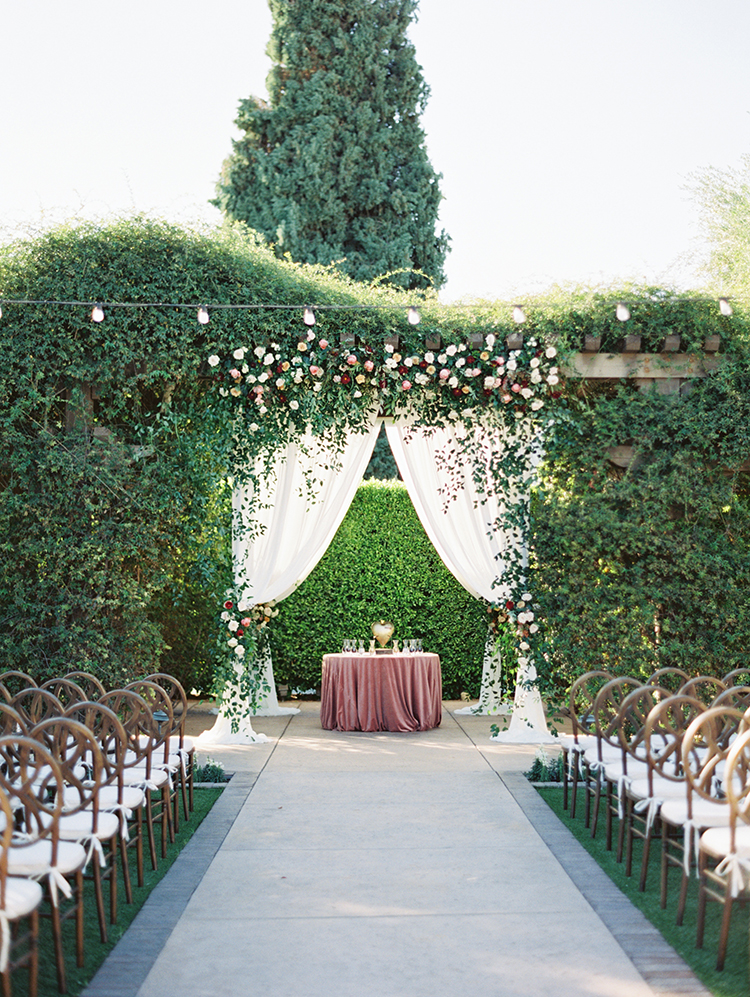 burgundy & blush wedding altar flowers with greenery