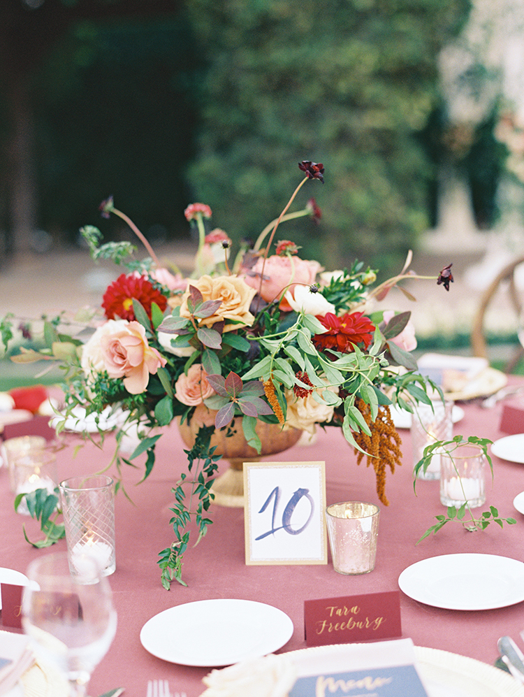outdoor reception with burgundy & navy decor