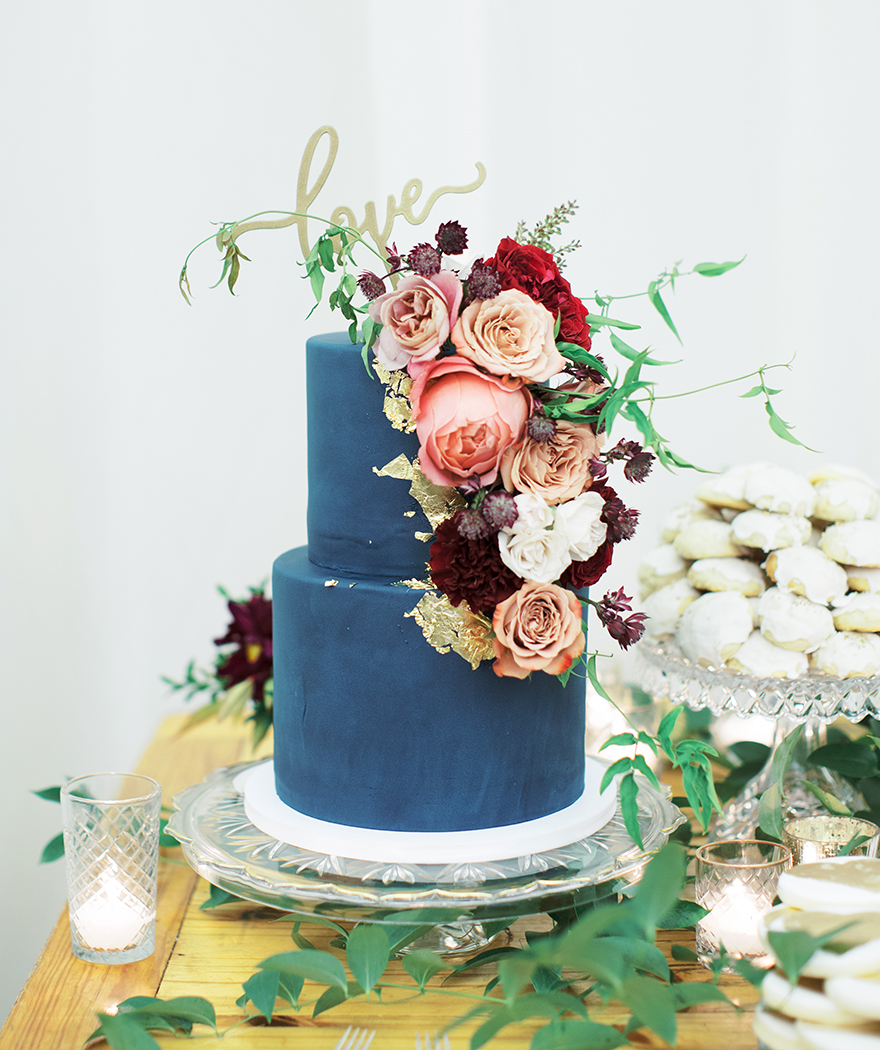 navy blue wedding cake with fresh flowers