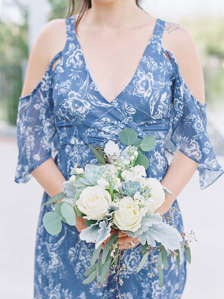 bridesmaid in blue patterned dress