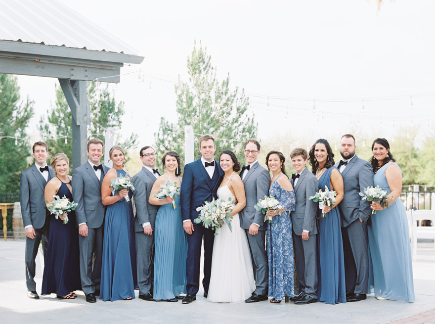 bridal party in blue and grey