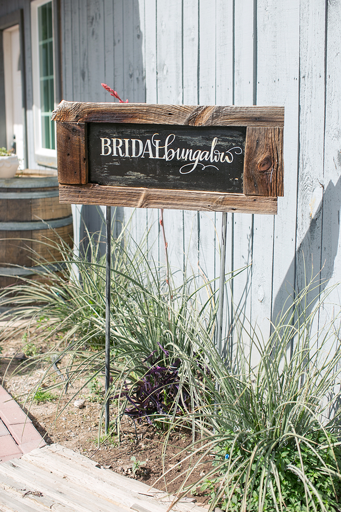 Cute chalk and wood handmade sign for bridal bungalow. Wedding ideas and inspiration.