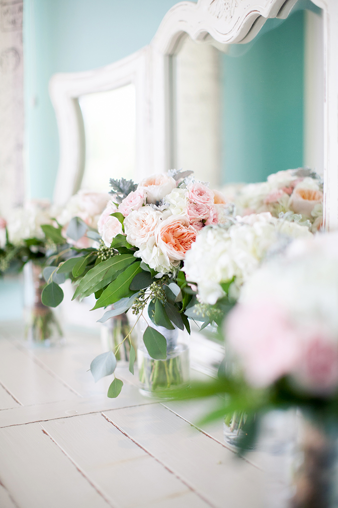 Gorgeous bouquets and floral arrangements of light pink and peach flowers.