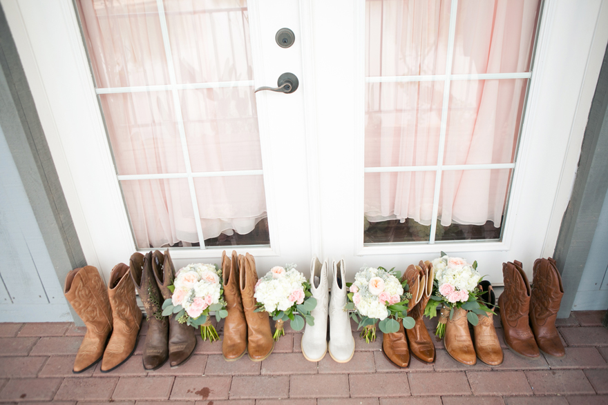 Country wedding cowboy boots for bridal party with bouquets. Wedding inspiration and ideas.