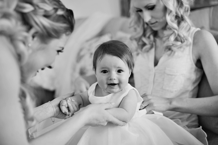 Beautiful baby girl getting dressed up for her parent's wedding day. Wedding inspiration and ideas.