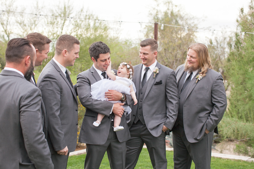 Groom with his baby daughter during the groomsmen portrait session.