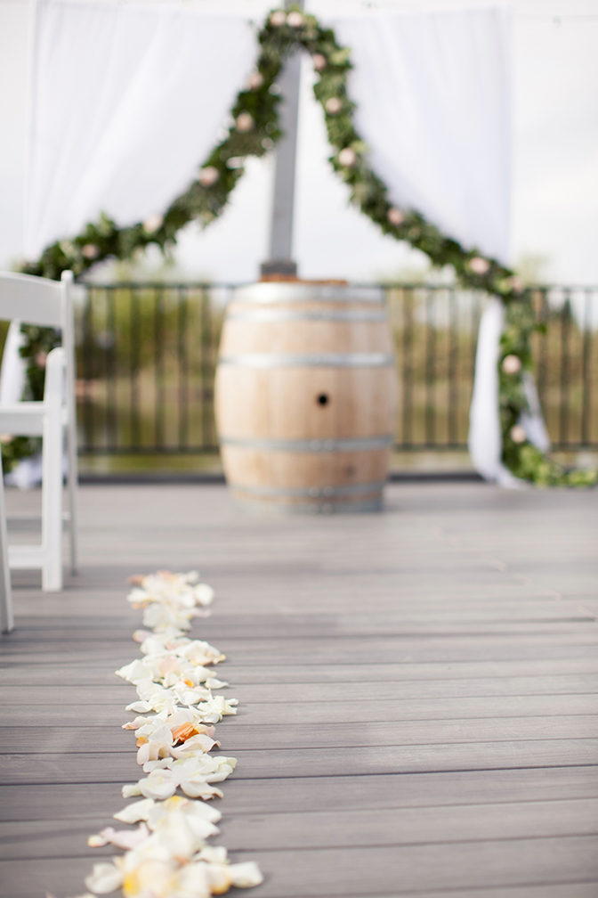 Flower petals down the isle at country inspired wedding. Wedding decor inspiration and ideas.