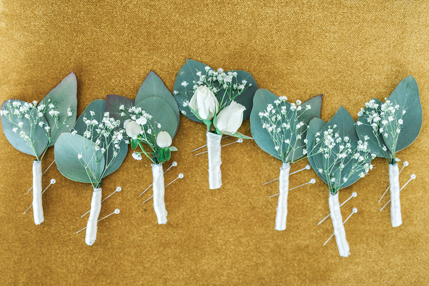 simple boutonnieres with baby's breath & greenery