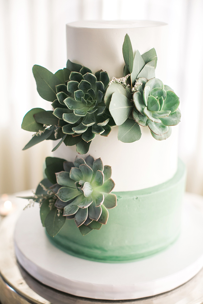 green & white wedding cake with succulents