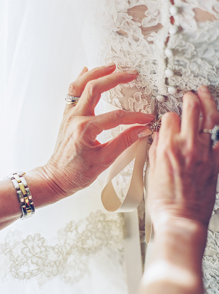 Mother of the bride adds the finishing touches