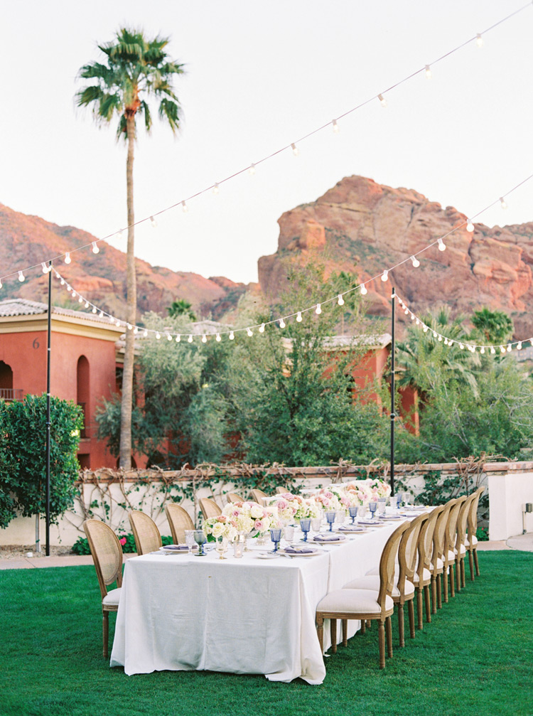 feasting table at an outdoor wedding reception