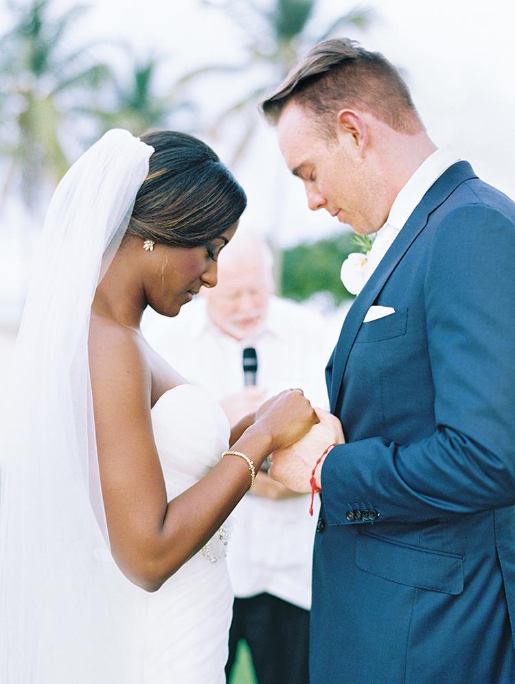 vows during a beach wedding in Punta Cana, Dominican Republic