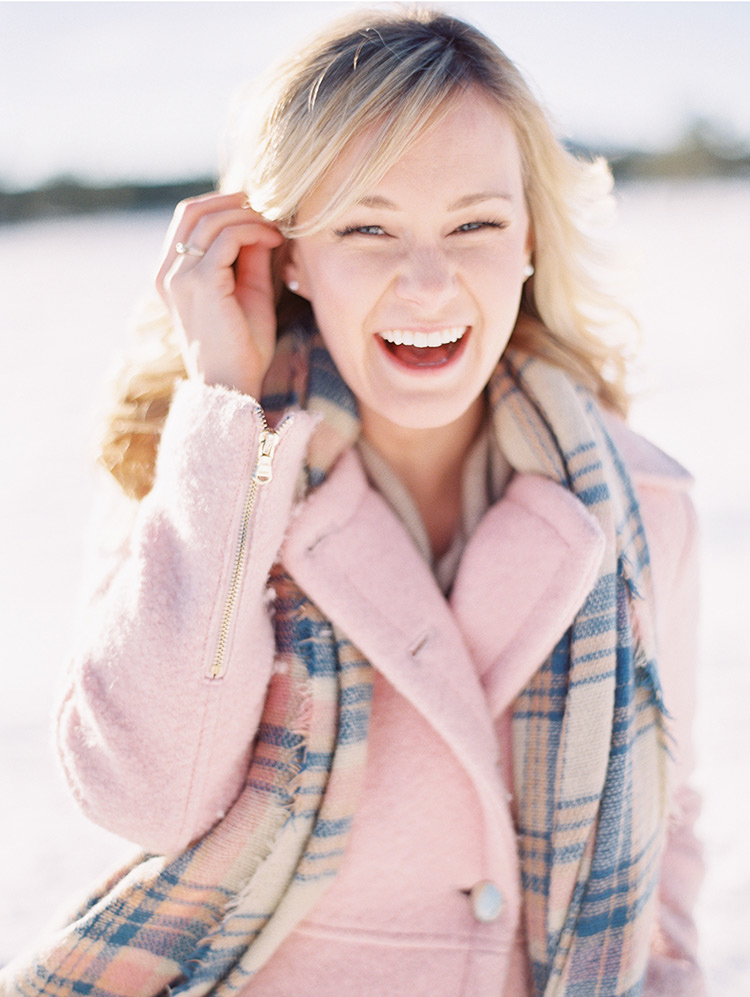 pink winter jacket with plaid scarf
