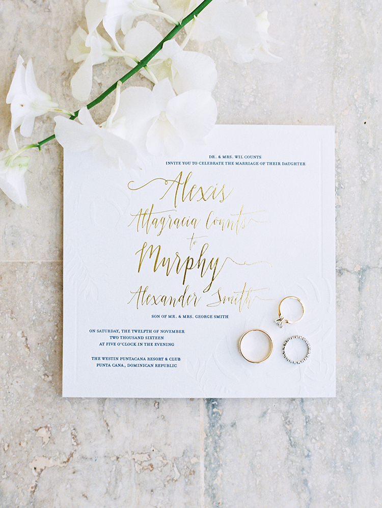 gold foil printed wedding invitation and wedding rings
